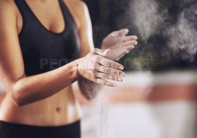 Buy stock photo Cropped shot of a woman coating her hands with sports chalk before a workout