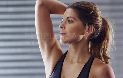 Buy stock photo Cropped shot of a young woman working out