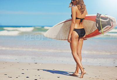 Buy stock photo Shot of a beautiful young surfer at the beach