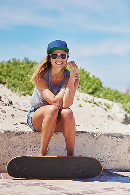Buy stock photo Shot of a young woman at the beach with her skateboard