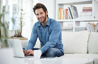 Buy stock photo Cropped portrait of a man browsing the internet at home
