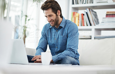 Buy stock photo Cropped shot of a man browsing the internet at home