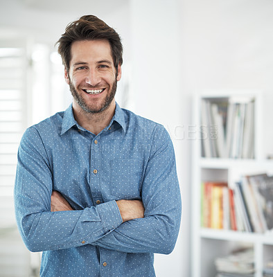 Buy stock photo Cropped portrait of a man standing with his arms folded at home