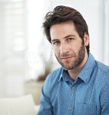 Buy stock photo Cropped portrait of a man sitting at home