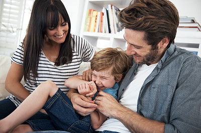 Buy stock photo Shot of a mother and father playing with their son at home