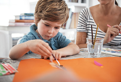Buy stock photo Shot of a little boy painting at home
