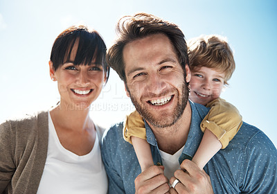 Buy stock photo Cropped portrait of a young family standing outside