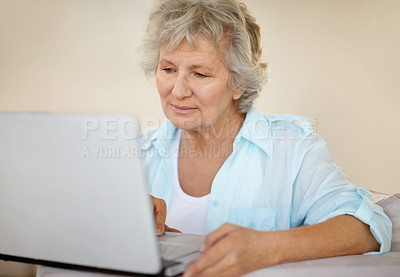 Buy stock photo A senior woman working on her laptop