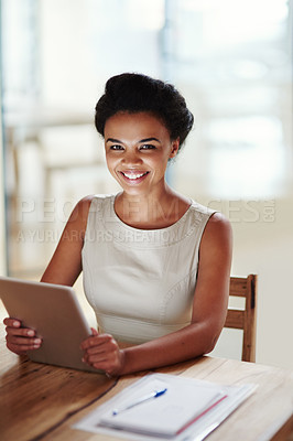Buy stock photo Shot of a businesswoman using a digital tablet in an office