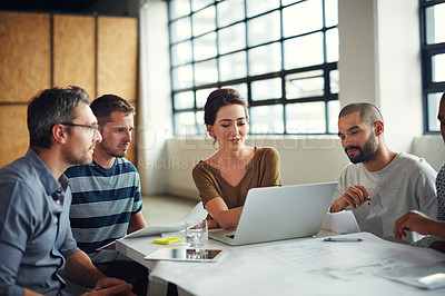 Buy stock photo Shot of a group of coworkers having a meeting in an open plan office