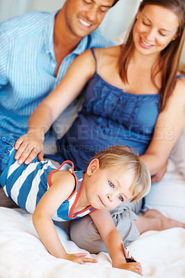 Buy stock photo Cute little boy having fun on the sofa with his parents