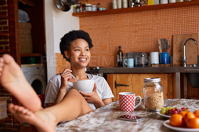 Buy stock photo Shot of a young woman having breakfast at home