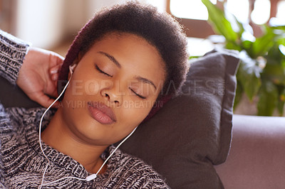 Buy stock photo Shot of a young woman falling asleep while listening to music