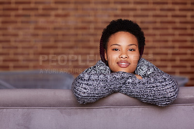 Buy stock photo Shot of a young woman relaxing at home
