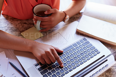 Buy stock photo Closeup shot of a young woman working drinking a coffee while working on a laptop