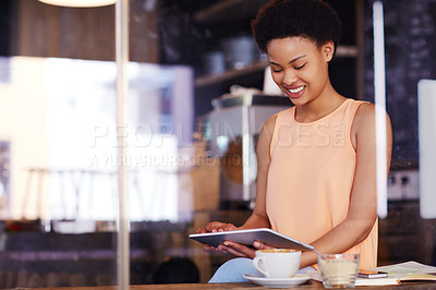 Buy stock photo Cropped shot of a young woman enjoying some alone time at her local coffee shop