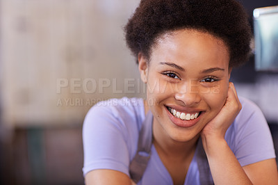 Buy stock photo Cropped portrait of a young woman working in her coffee shop
