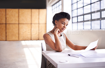 Buy stock photo Shot of a businesswoman working on paperwork