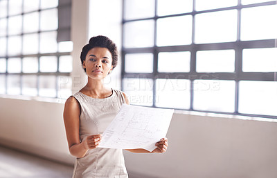 Buy stock photo Shot of a female architect holding a blueprint