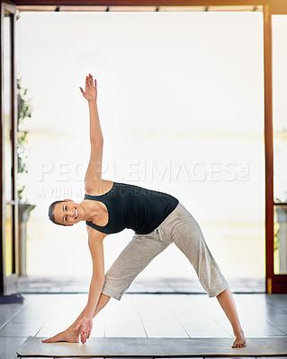 Buy stock photo Full length portrait of a young woman stretching before a workout
