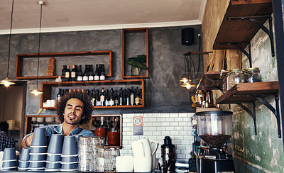 Buy stock photo Shot of a young barista working in a coffee shop