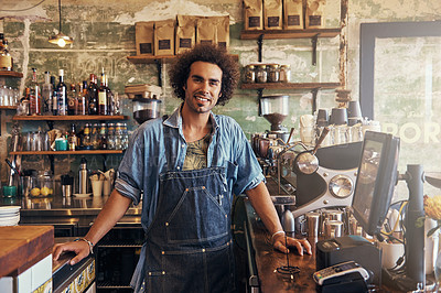 Buy stock photo Portrait of a young barista working in a coffee shop