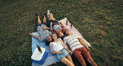 Buy stock photo Shot of four friends out on a picnic
