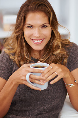 Buy stock photo Portrait of a young woman enjoying a cup of coffee at home