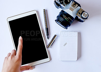Buy stock photo High angle shot of a photographer using a tablet on her desk