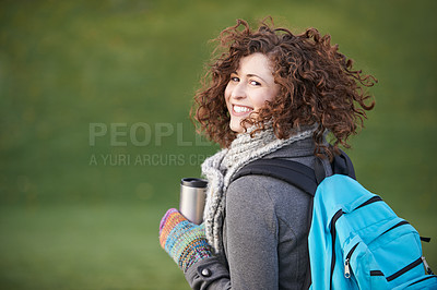 Buy stock photo Shot of a young woman wearing winter clothing while walking outdoors