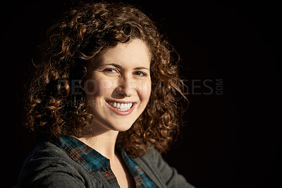 Buy stock photo Shot of a young woman against a black background