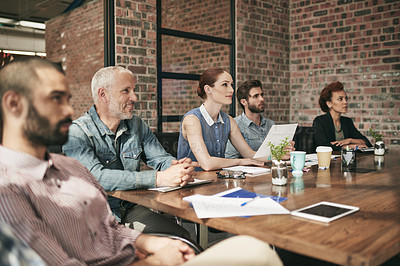 Buy stock photo Shot of a team of businesspeople having a meeting in an office