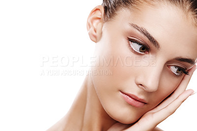 Buy stock photo Studio shot of a beautiful young woman touching her face isolated on white