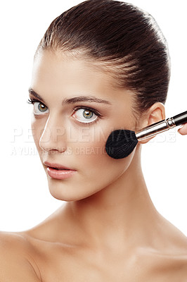 Buy stock photo Studio portrait of a beautiful young woman applying makeup isolated on white