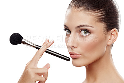 Buy stock photo Beautiful woman applying make-up with a cosmetic brush