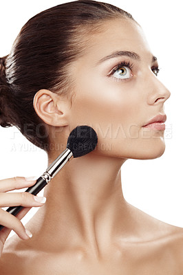 Buy stock photo Studio shot of a beautiful young woman applying makeup isolated on white