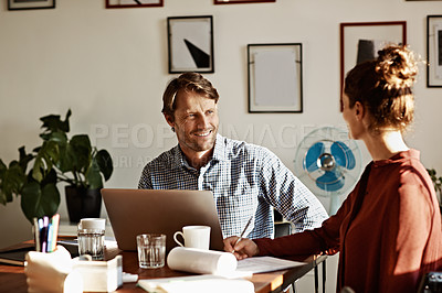 Buy stock photo Shot of a couple working together at home