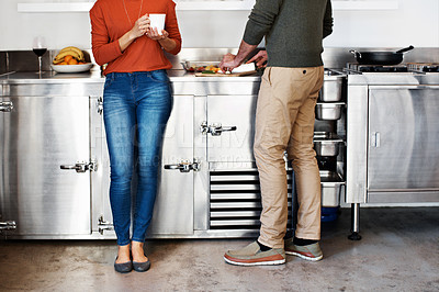 Buy stock photo Cropped shot of a couple cooking in their kitchen