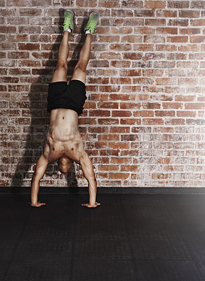 Buy stock photo Full length shot of a young man working out in the gym