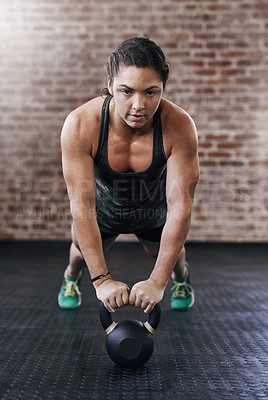Buy stock photo Full length shot of a young woman working out in the gym