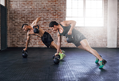Buy stock photo Full length shot of two young athletes working out in the gym