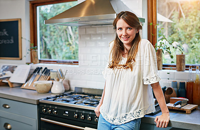 Buy stock photo Portrait of a smiling young woman standing in a kitchen