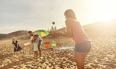 Buy stock photo Shot of a happy family playing cricket on the beach