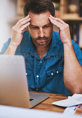 Buy stock photo Cropped shot of a businessman looking stressed while working at home