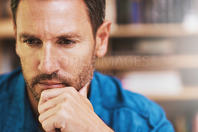 Buy stock photo Cropped shot of a businessman looking thoughtful while working at home