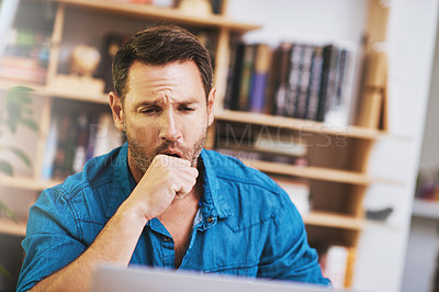 Buy stock photo Cropped shot of a businessman looking tired while working at home