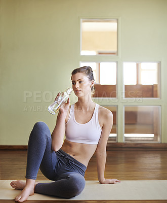 Buy stock photo Shot of a woman having water after her yoga session