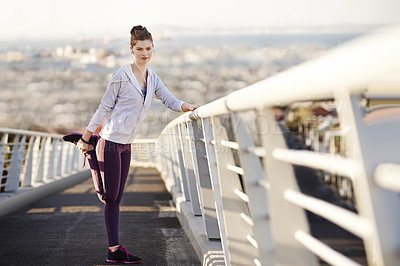 Buy stock photo Full length portrait of an attractive young woman stretching before her morning run