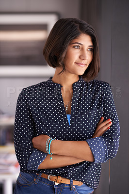 Buy stock photo Shot of an ambitious young woman looking thoughtful in an office