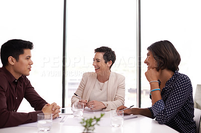 Buy stock photo Cropped shot of three businesspeople meeting in the boardroom